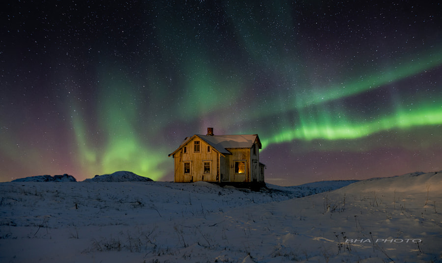 Northern lights with the house by the sea. by Bjorn H Andersen on 500px.com