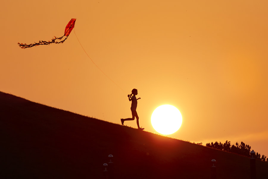 girl flying a kite at sunset by Hayri Kodal on 500px.com