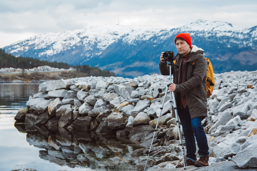 Travel photographer man taking nature video of mountain landscape. Professional videographer on adve by Andriy Olkhovyy on 500px.com