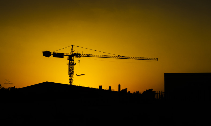 """ Tower crane Holding the plane "" by Mahmoud Marei on 500px.com"