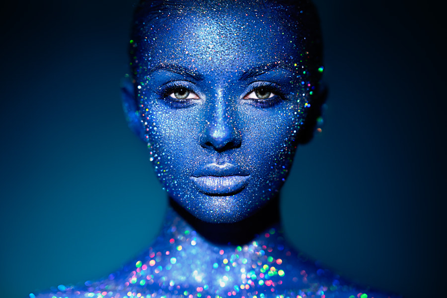 Portrait of beautiful woman with sparkles on her face by Oleg Gekman on 500px.com