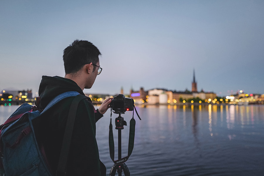 Photographer taking photos with Riddarholmen urban skyline at sunset Stockholm Sweden by Lingxiao Xie on 500px.com