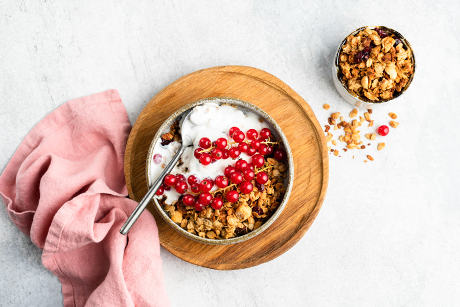 Breakfast cereal oat granola with yogurt and berries by Vladislav Nosick on 500px.com