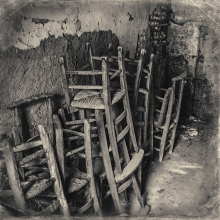 Piles of old chairs in Les Eyzies (iPhone 6)