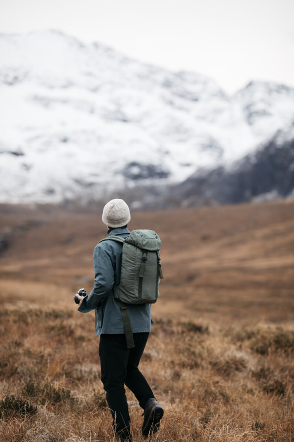 Man exploring outdoor snowy mountains with backpack by Cameron Prentice on 500px.com