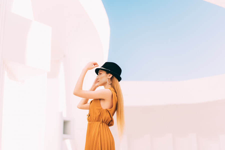 Young Woman in Orange Dress traveling by Petar Tutundziev on 500px.com