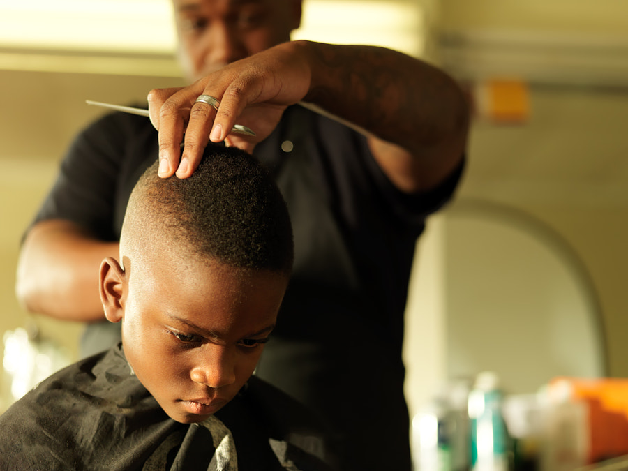 little boy getting hair cut by barber by Joshua Resnick on 500px.com