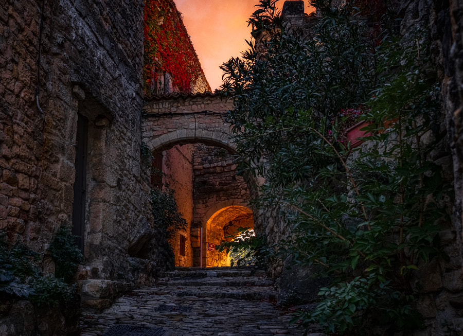 Sunset through Arch by Jerry Nichols on 500px.com