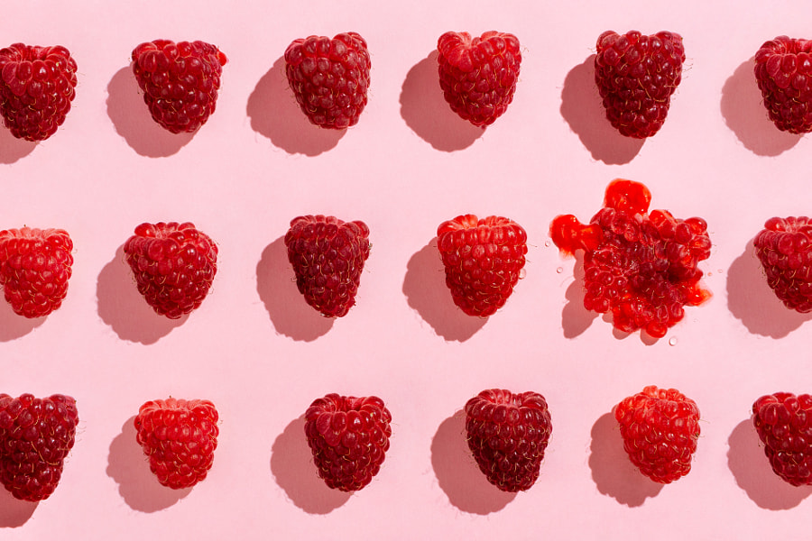 Flatlay of arranged raspberries on pink by Nataly Lavrenkova on 500px.com