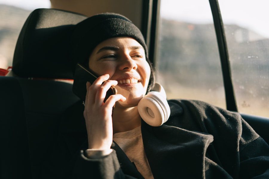 Young girl talking on a mobile phone while traveling by Petar Tutundziev on 500px.com