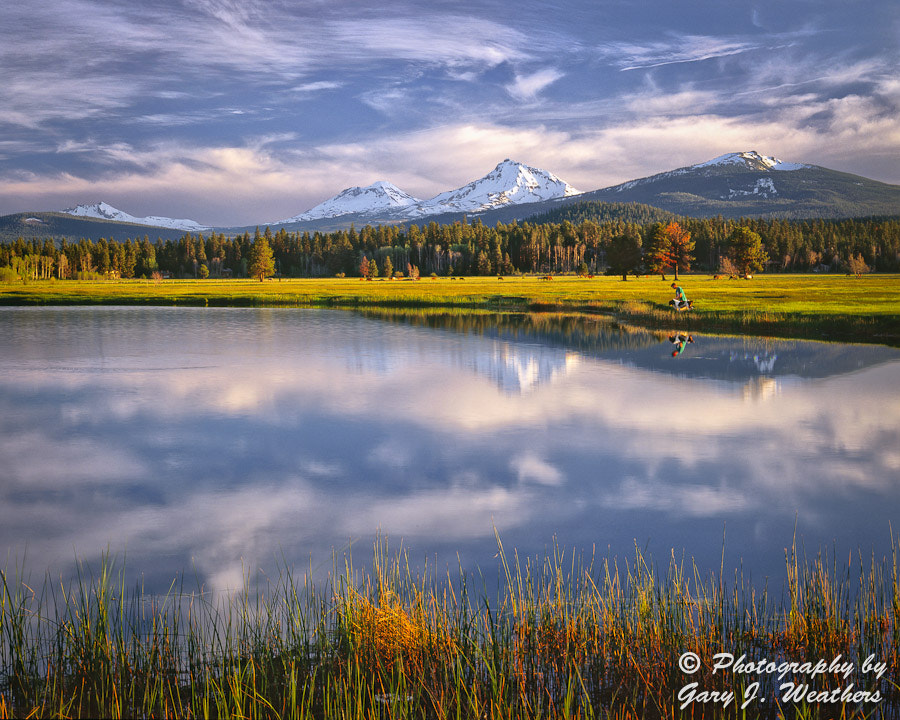 Photograph Sisters Mountains from Black Butte Ranch by Gary Weathers on 500px