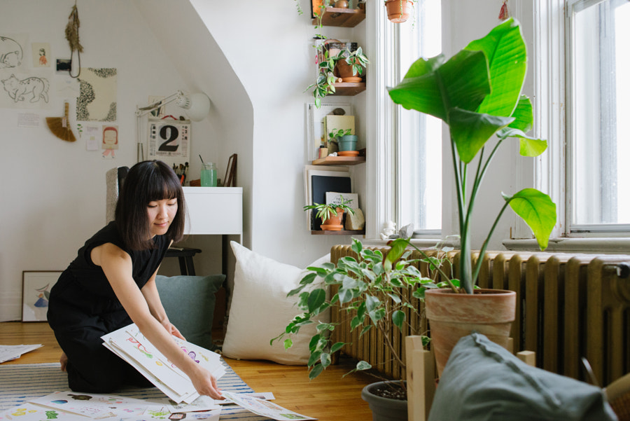 Artist sorting paintings at home, Justine W by PAM LAU on 500px.com