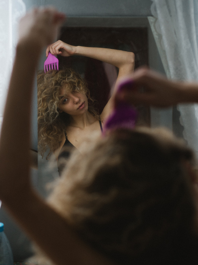 woman brushing her curly hair, Russia, Anna Koniashkina by Aks Huckleberry on 500px.com