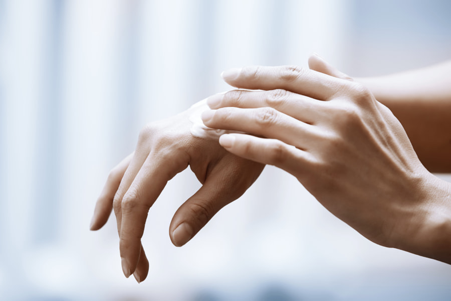 Woman applying moisturizing cream on hands by ????? ???????? on 500px.com