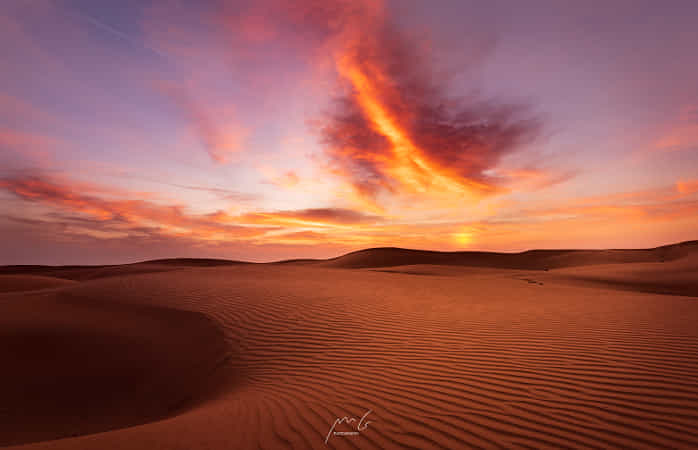 Dawn in Wahiba sands by Marco Gelpi