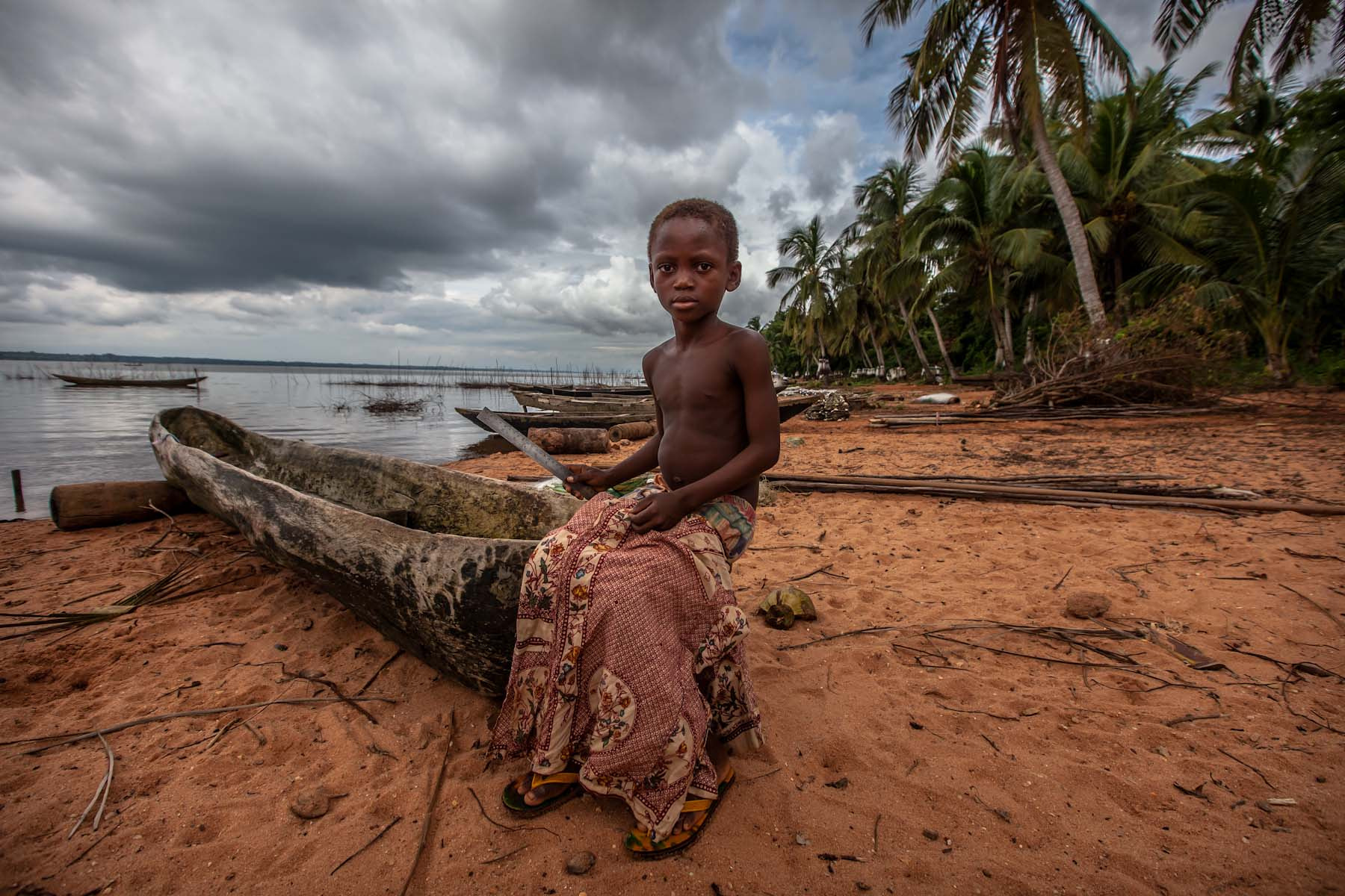 Photograph portrait of a child on the shore of Lake possotome by Anthony Pappone on 500px