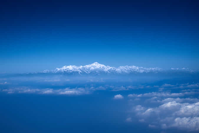 https://500px.com/photo/1014691153/Himalayan-mountain-range-above-clouds-by-Dinesh-J-Weerakkody