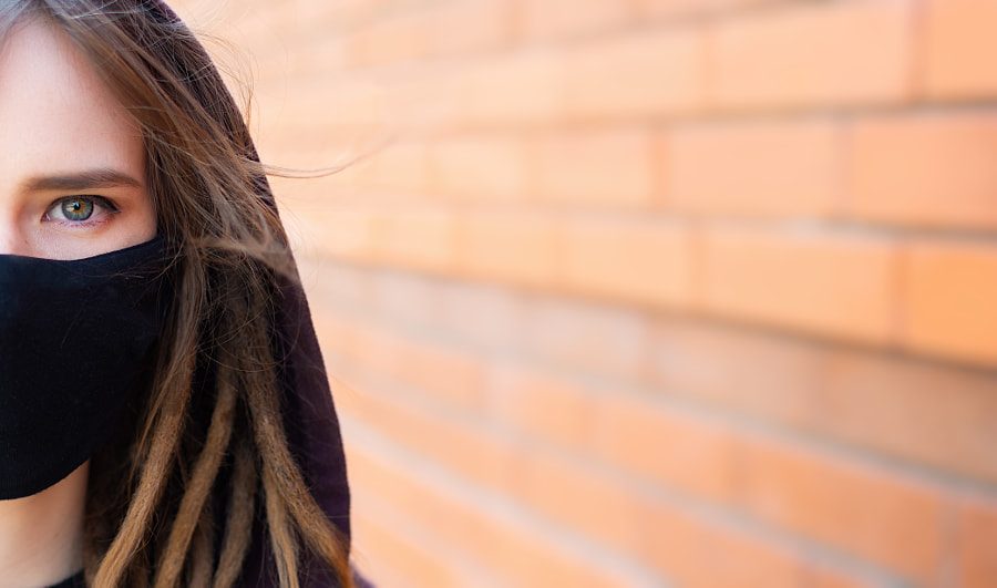 Close-up portrait of girl with dreadlocks and green-blue eyes, wearing by Alexander Dadyev on 500px.com