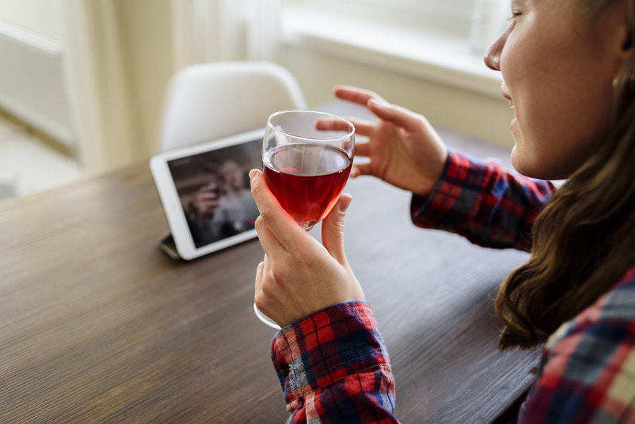 Woman drinking wine online with male friend by Tatyana Aksenova on 500px.com