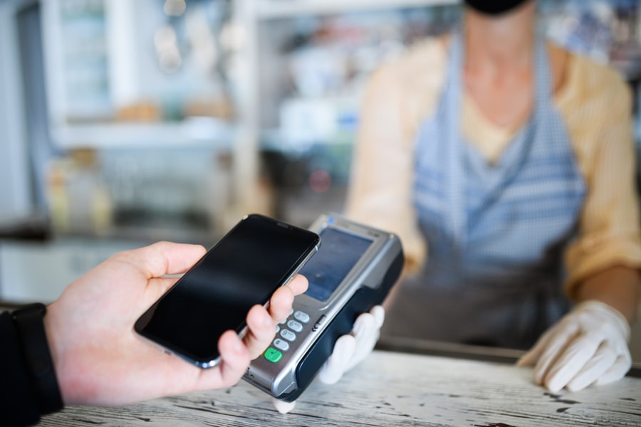 Contactless payment with smartphone, coffee shop open after lockdown. by Jozef Polc on 500px.com