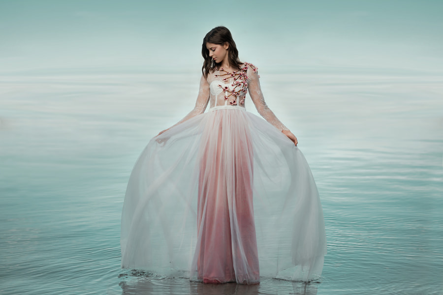 Full length shot of beautiful young woman in dress standing on water by Tamara Savkovic on 500px.com