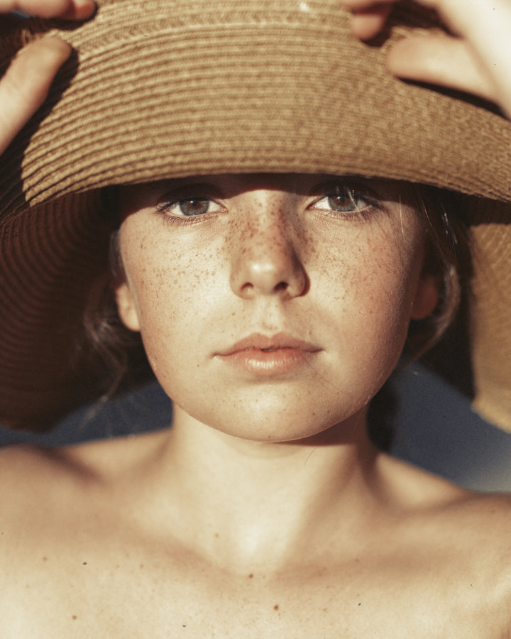 girl with hat  by raquel chicheri on 500px.com