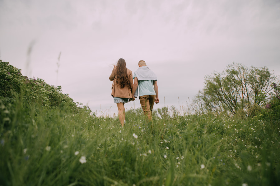 young couple holding hands on a walk by Alena Sadreeva on 500px.com