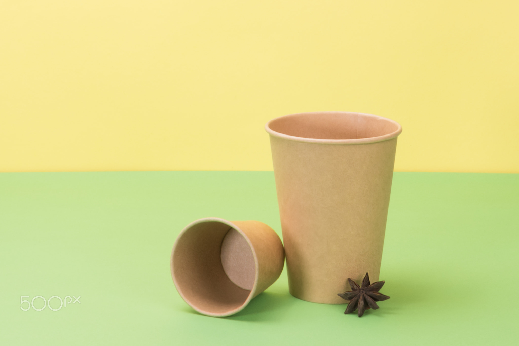 Kitchenware environmental and star anise on yellow, green background.