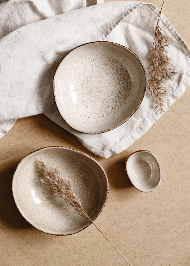 Modern minimalist ceramics set with a linen cloth over kraft paper  by Edalin Photography on 500px.com