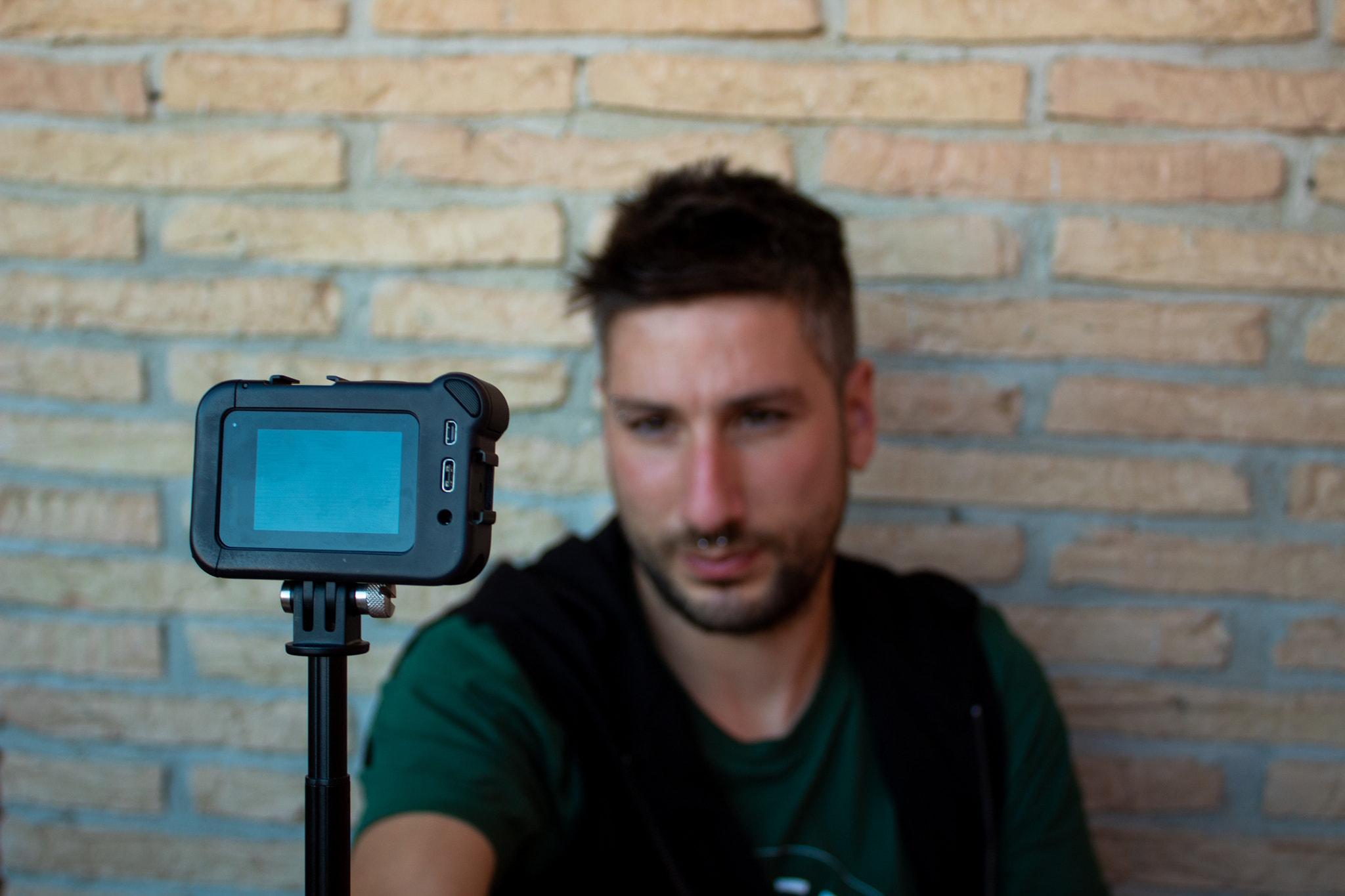 Social media influencer using the camera.