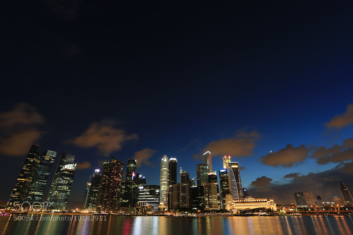Photograph Marina Bay and Raffles Place (taken from Marina Bay Sands) by GengHui Tan on 500px