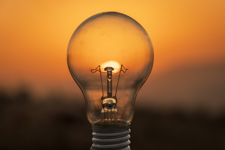 - electric light bulb and sun at sunset  by Noureddine Belfethi on 500px.com