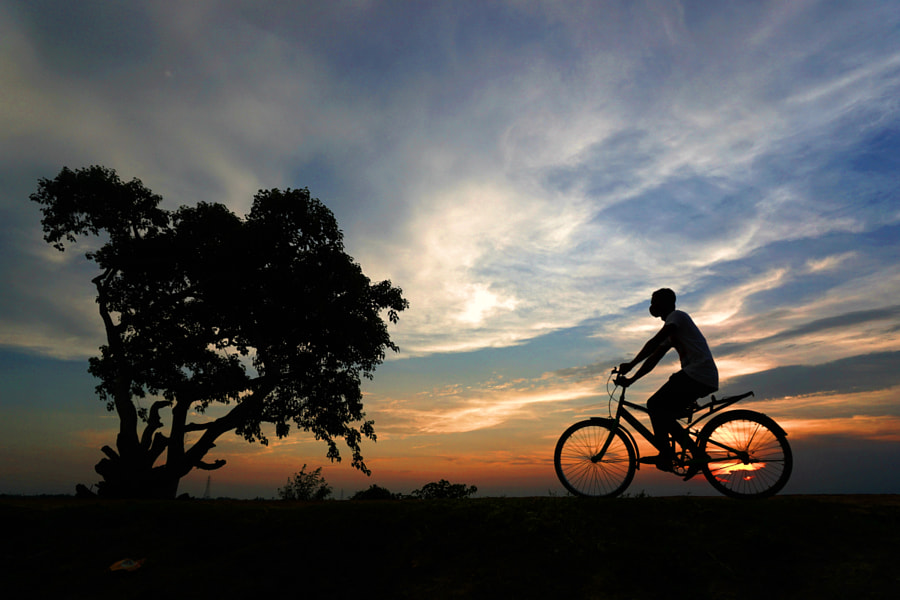 Sunset and cycling  by Rozel Kazi 🇧🇩 on 500px.com