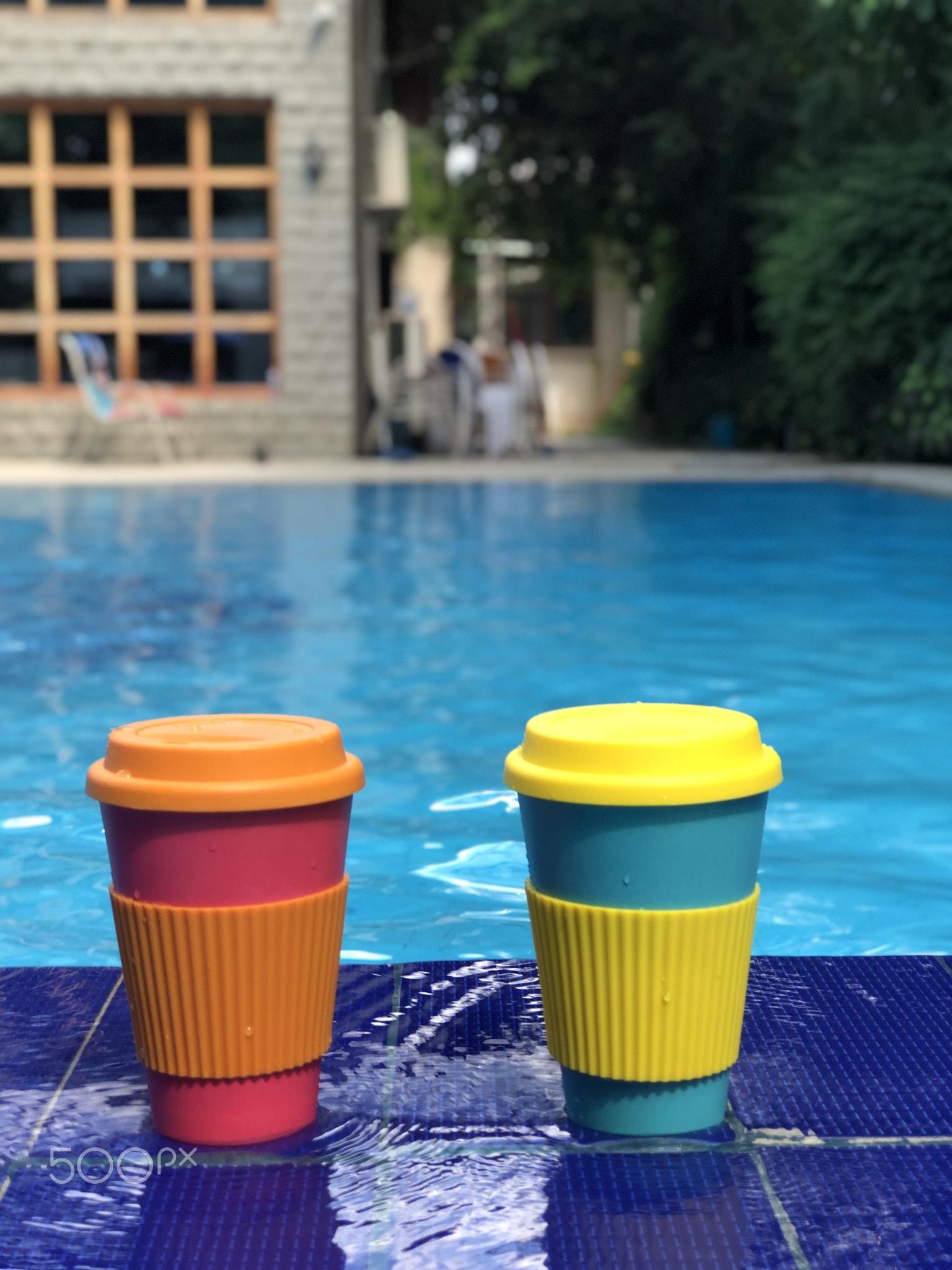 reusable bamboo mug at the swimming pool