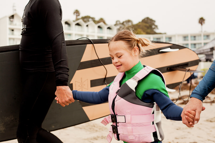 Little girl with Down Syndrome getting ready to surf by Anna Neubauer on 500px.com