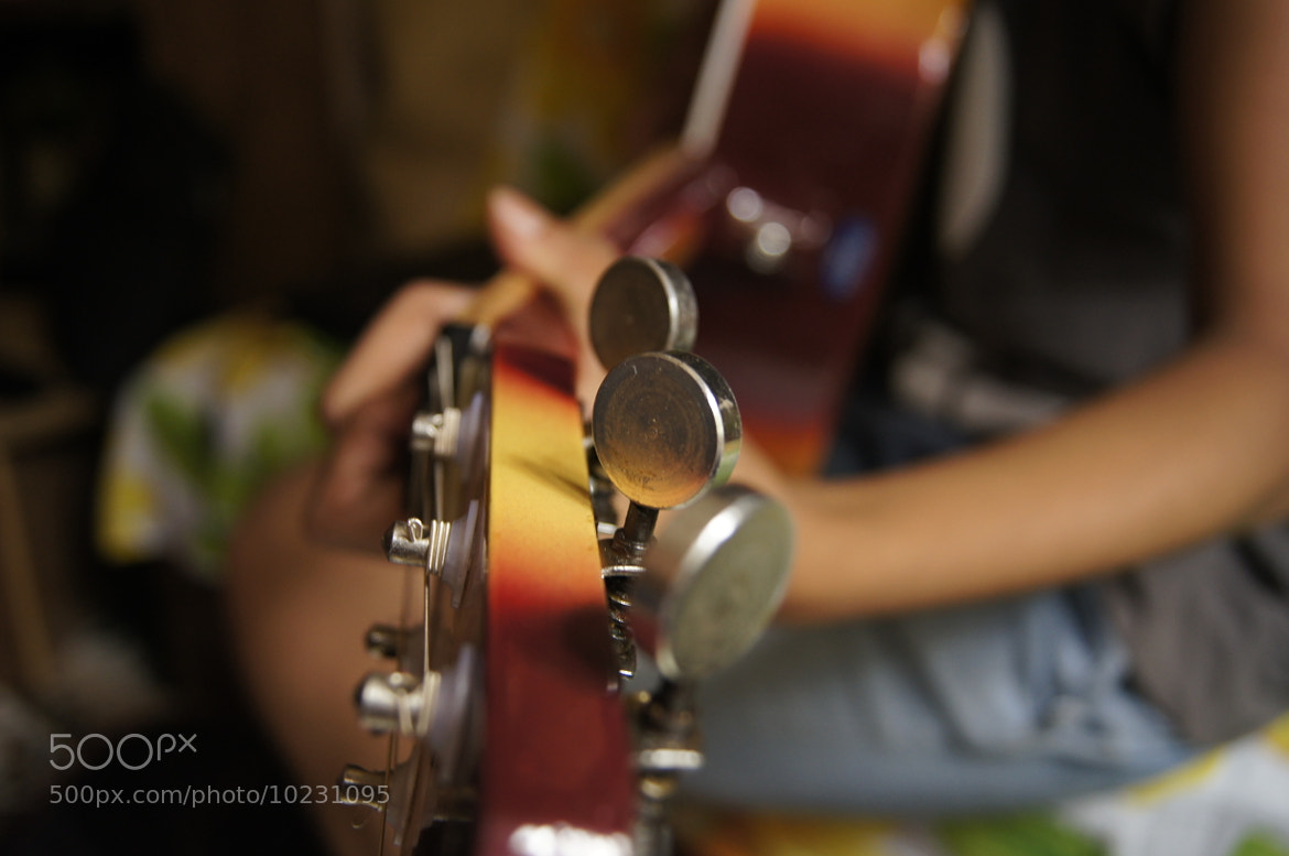 Photograph building up harmonies using the guitar by Afzal Khan on 500px