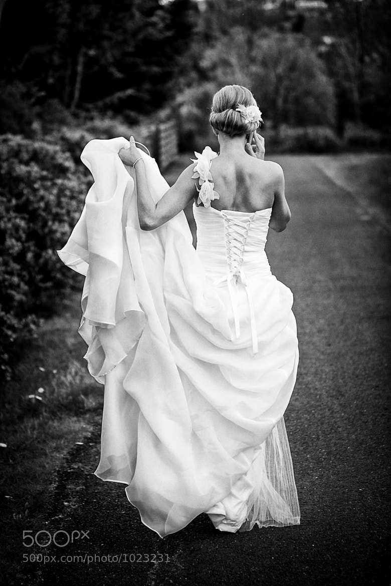 Photograph Bride making last minute plans by Bent Marinosson on 500px