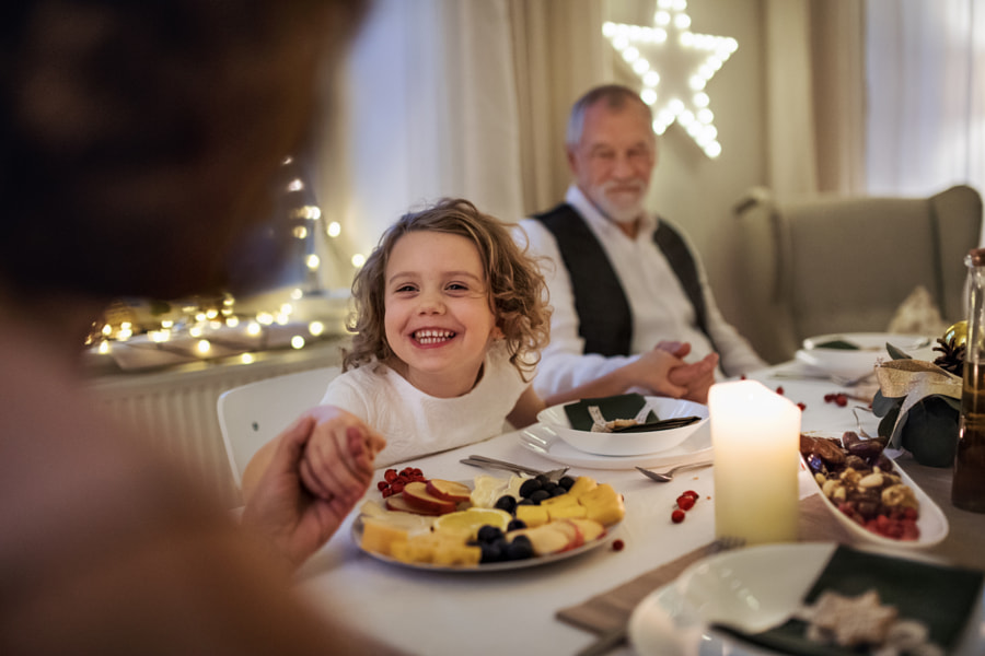 Small girl with grandparents sitting indoors celebrating Christmas by Jozef Polc on 500px.com