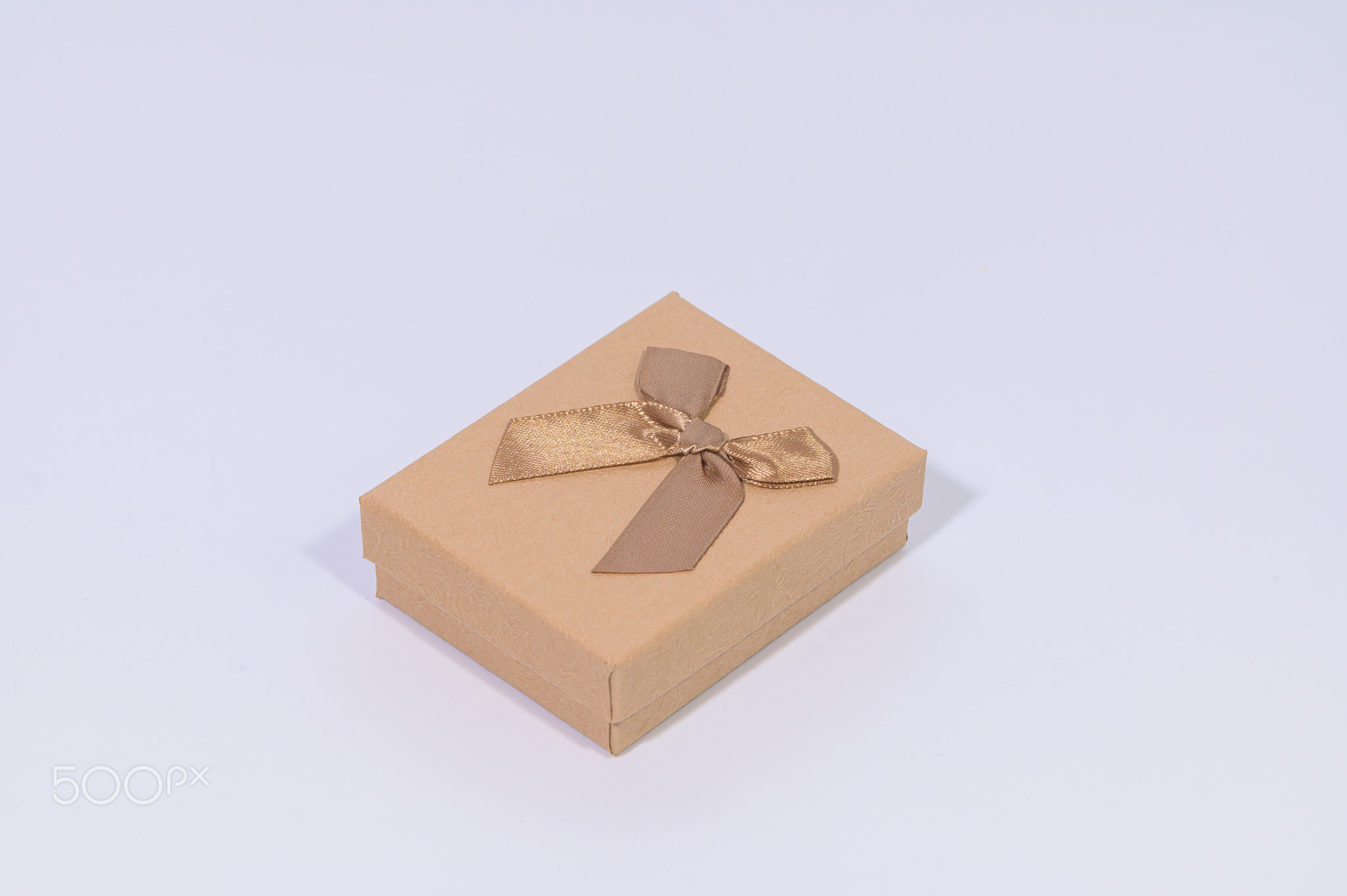 A brown gift box on a white background