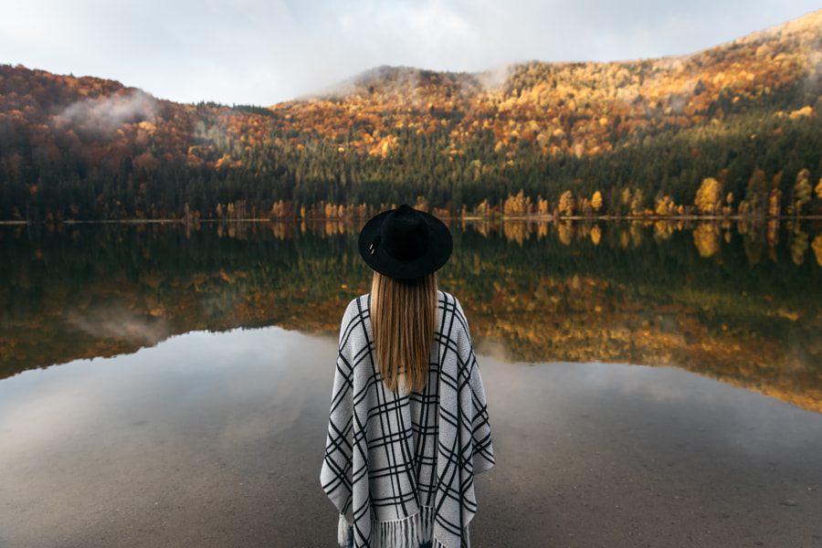 Young woman wearing hat and poncho in autumnal forest lake by Szabo  Ervin-Edward on 500px.com