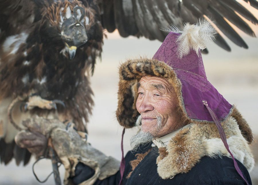 elderly kazakh eagle hunter posing with golden eagle by Kevin Pepper on 500px.com
