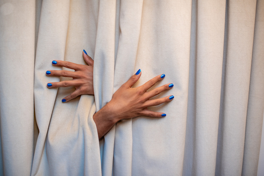 Close up shot of hands protruding from behind curtain by Rushay Booysen on 500px.com