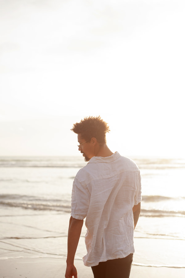 Portrait of young biracial man from behind by Anna Neubauer on 500px.com