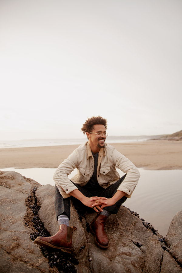 Portrait of young biracial man at the beach by Anna Neubauer on 500px.com