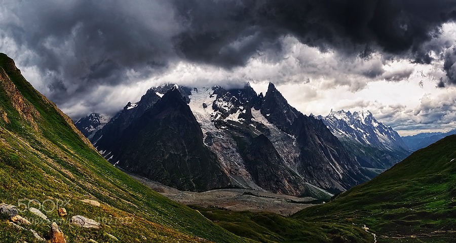 Advancing cold front engulfs the highest mountain of the Alps, Mont Blanc (4810m), as thunders echo through the valley. Soon clouds will swallow everything, and buckets of rain and hail mix will fall...