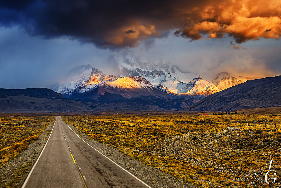 Argentine Patagonian steppe suddenly turns into the Andes so the Fitz Roy group (3405m) abruptly rises into the sky decorated with typical Patagonian weather and the rising sun