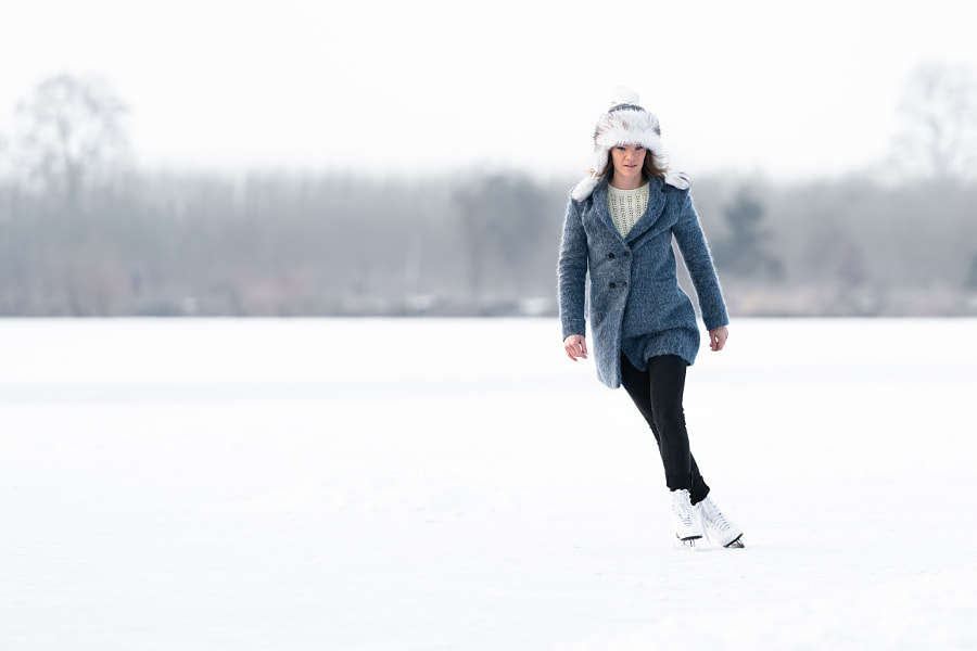 ice skating on the ice of a frozen lake young attractive woman by Eduard Goricev on 500px.com