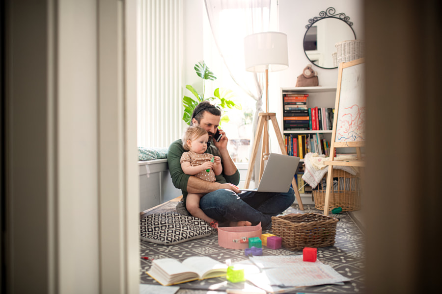 Father working with small toddler daughter in bedroom home office by Jozef Polc on 500px.com