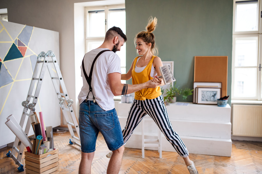 Couple having fun when painting wall indoors at home, relocation and by Jozef Polc on 500px.com
