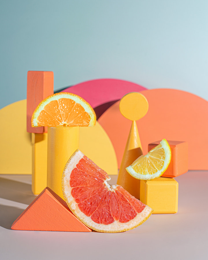 Vibrant still life with different citruses and geometric shapes.  by Oleksandra Mykhailutsa on 500px.com